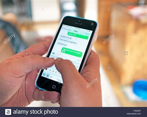 A teenager texting on a smart phone Stock Photo, Royalty