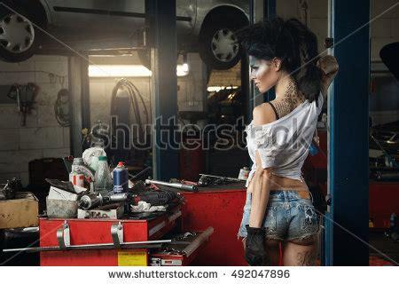 Frau In Garage by Mechanic Garage Artistic Makeup On Stock Photo