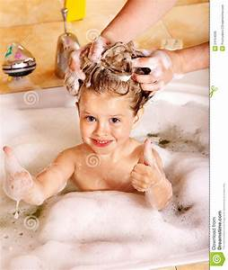 Kid Washing Hair By Shampoo Royalty Free Stock Photo