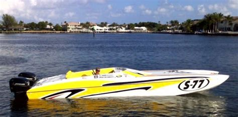 Yellow Cigarette Boat by Shore Power Boats