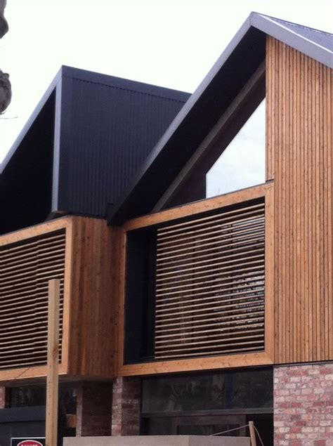 Love the use of recycled brick , wood and steel exterior
