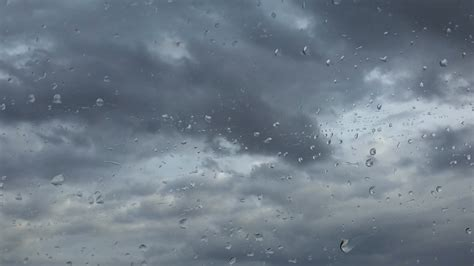 Weather Background Rainy Days Drops On Window Pane Of A Car In Motion