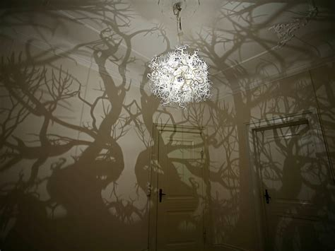 light tree on wall coolest light fixture ever it projects forest shadows on