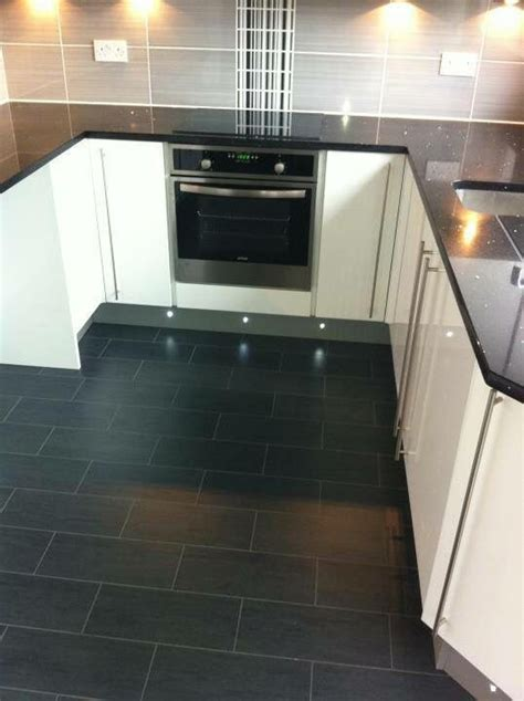 black granite worktop grey  black tiles white gloss