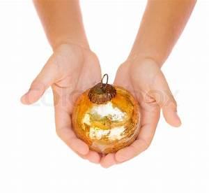 Hands holding christmas ball Stock Photo Colourbox