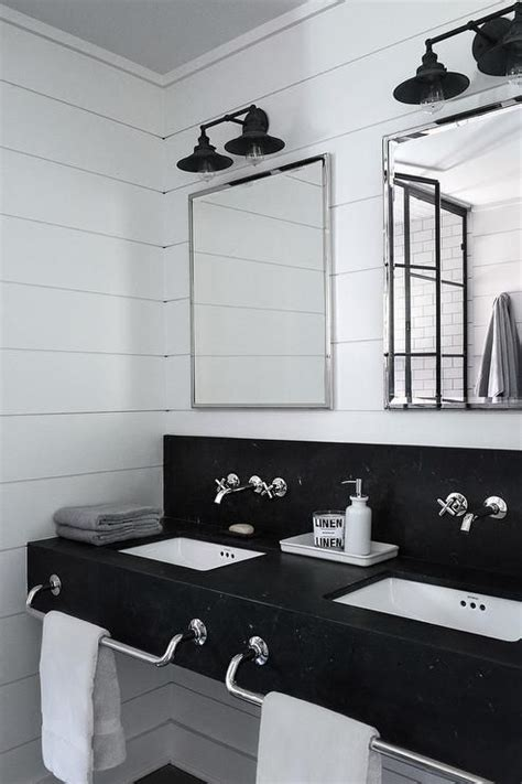 black  white industrial bathroom features  honed black