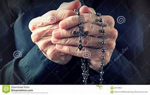 Hands Of An Elder Woman Holding A Rosary While Praying ...