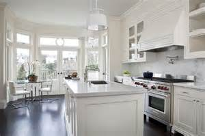 kitchen cabinets with white marble countertops