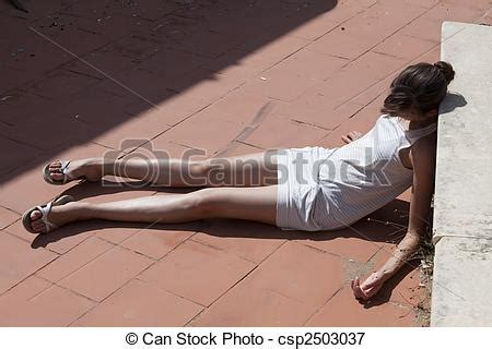 Unconscious Woman in Dress