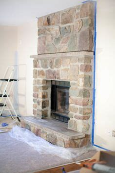 white washed stone fireplace  annie sloan chalk paint