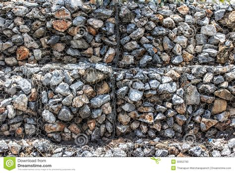 rock walls in wire mesh natural stones in retain a wire mesh gabion wall stock photo image 30952790