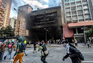 Protesters set fire to government buildings in Venezuela ...