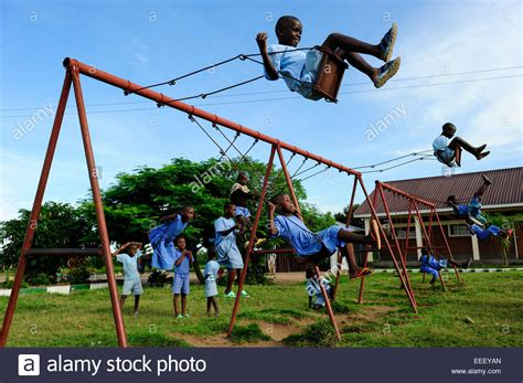 Children Swing by Tanzania Bukoba Children Play At Swing Of Playground In