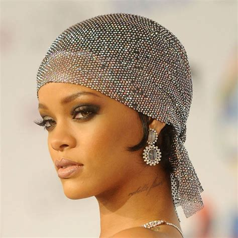 rihannas eye popping barely  red carpet gown