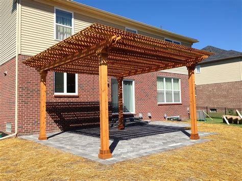 cedar pergola  lattice top   unilock patio