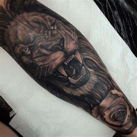 fun finishing   lion  adding  rose today  drew  tattoo bookings email
