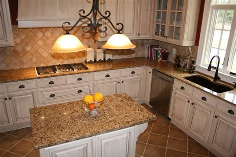 tile medallions for kitchen backsplash white cabinets with brown granite help with granite for