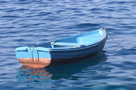 Floating Boat Images quot small boat floating on water quot by gysworks redbubble