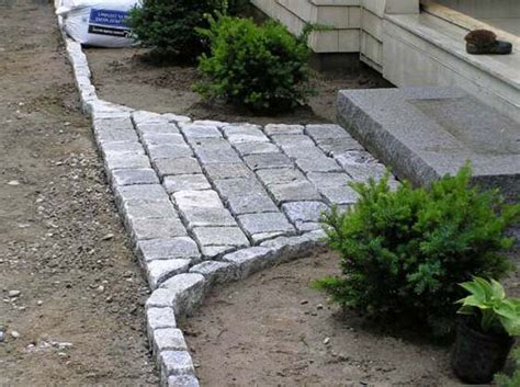 landscaping project by jm landscaping granite cobbles