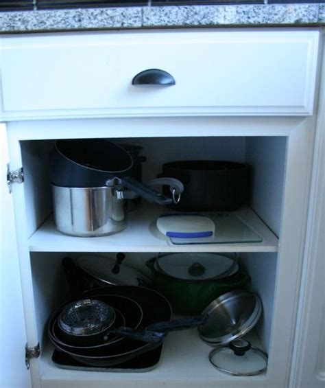 organizing pots and pans in kitchen cabinets organizing your pots pans cabinet drawers drawers and 9673