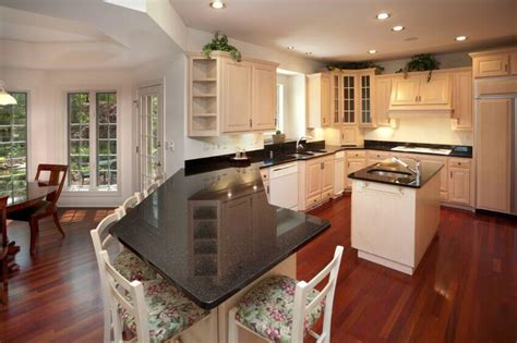 inspiring kitchens  white cabinets  dark granite