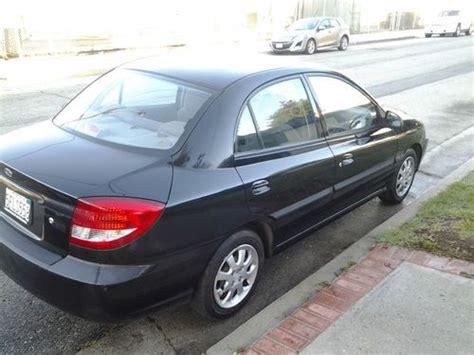 purchase   kia rio base sedan  door