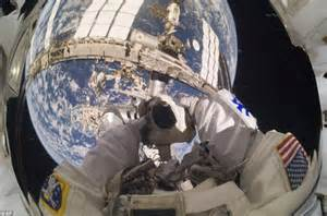 Space station: Astronaut takes stunning self-portrait with ...