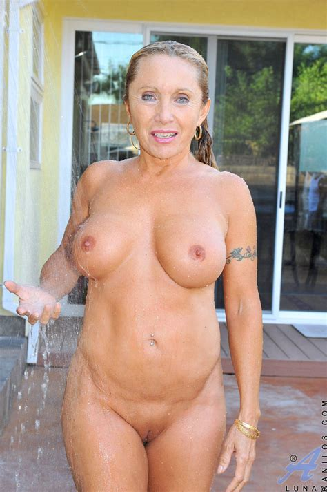 Hot Mom With Massive Tits Enjoys Her Pool While Floating Around Naked With A Finger In Her