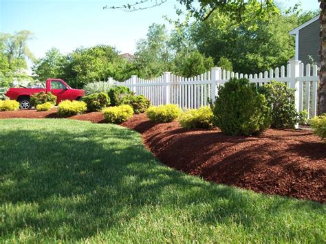 mulching garden beds raised beds w mulch and a fence home sweet home pinterest