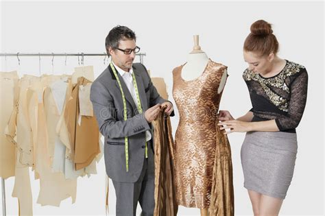 Fashion Designers Working Together On An Outfit In Design