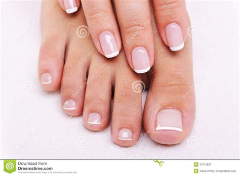 Beauty Nails Of A Female Hand And Feet Stock Image