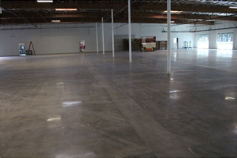 the floor warehouse testing two new colors for staining floors before polishing the concrete polishedcrete