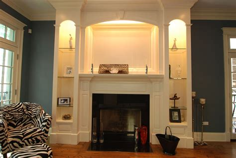 living room large two white wooden bookcase with shelves and storage having glass door added by