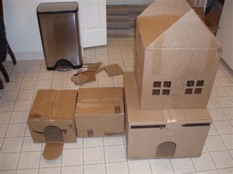 cardboard boxes connected  cat maze playhouse picture