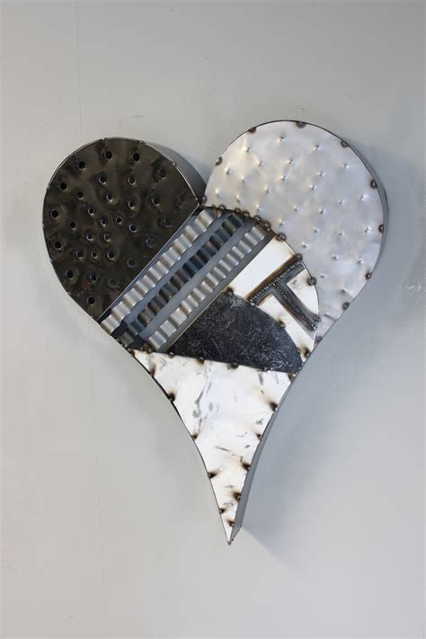 Fill your home with incredible, rustic designs. Cannonball Metal Works   (530) 722-5454   Metal Heart Wall Art