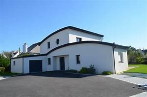 Deux toitures cintrees en zinc recouvre cette elegante for Extension maison en l 15 deux toitures cintrees en zinc recouvre cette elegante