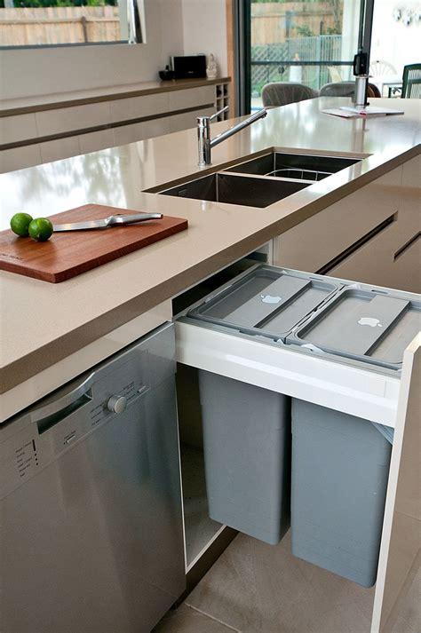 kitchen design idea hide pull  trash bins