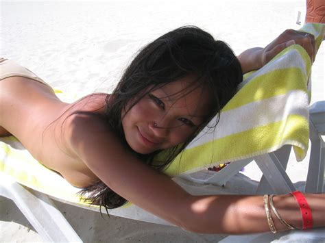 nearly a supermodel asian teen posting topless at the