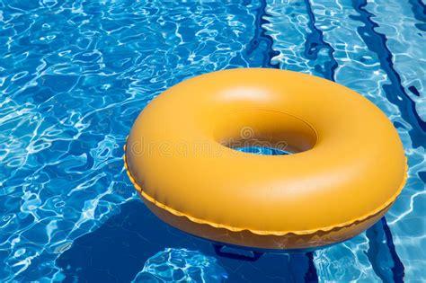 Swimming Pool Inner Tube Stock Photo. Image Of Drop