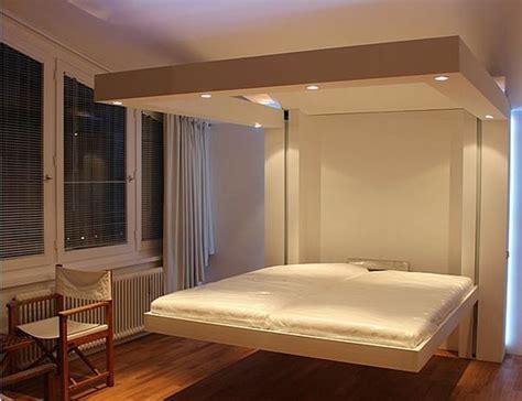 chambre ouverte sur salle de bain superbe lit suspendu au plafond 1 un lit escamotable
