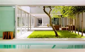 Atrium House in Munich Harlaching / Max Brunner Architekt