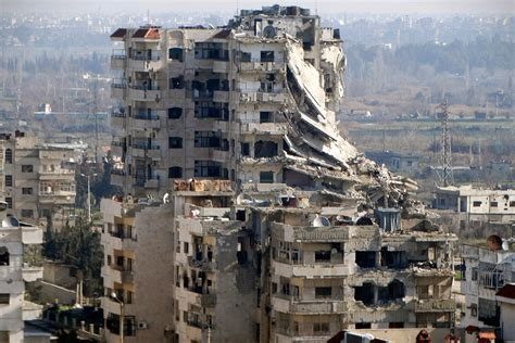 Syria Shattered city of Homs returns to Assad control as