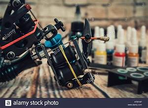 Tattoo Machine And Tattoo Supplies On Wooden Background