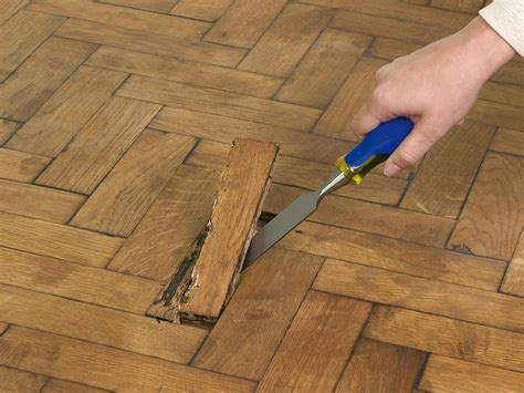 Replacing Hardwood Floors With Tile by How To Repair Parquet Flooring How Tos Diy