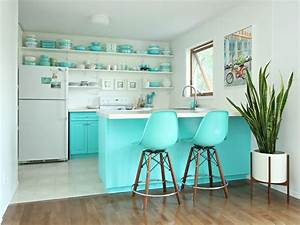 Colorful painted kitchen cabinet ideas hgtv39s decorating for Kitchen colors with white cabinets with wagon wheel wall art