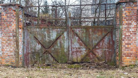 picture gate rust brick wall metal fence