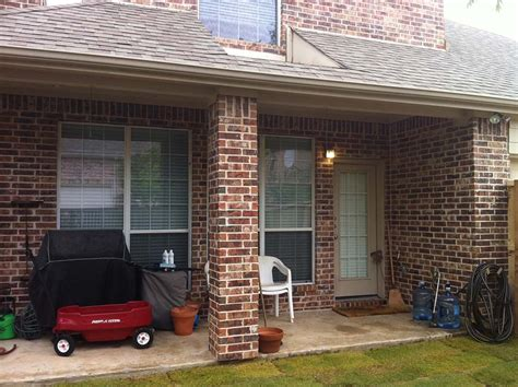 Small Shingled Patio Cover With Brick Pillars In Frisco