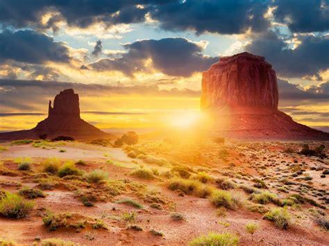 sunset sun rays desert region red sand sky white clouds