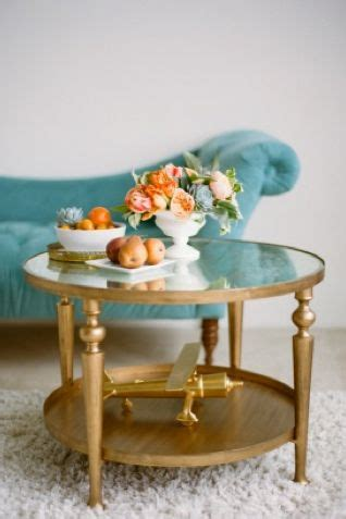 The most common fancy coffee table material is metal. peach and teal   Coffee table, Gold coffee table, Decor