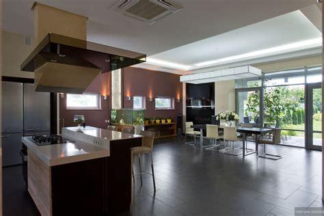 modern gas kitchen dining  fish tank  high shine flooring garden view interior design